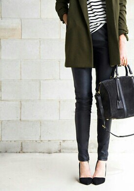 Leather and stripes paired with classic black accessories and an olive coat is perfectly timeless